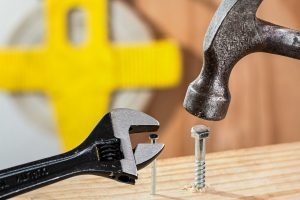 Confusion is shown by a wrench gripping a nail and a hammer pounding a screw.