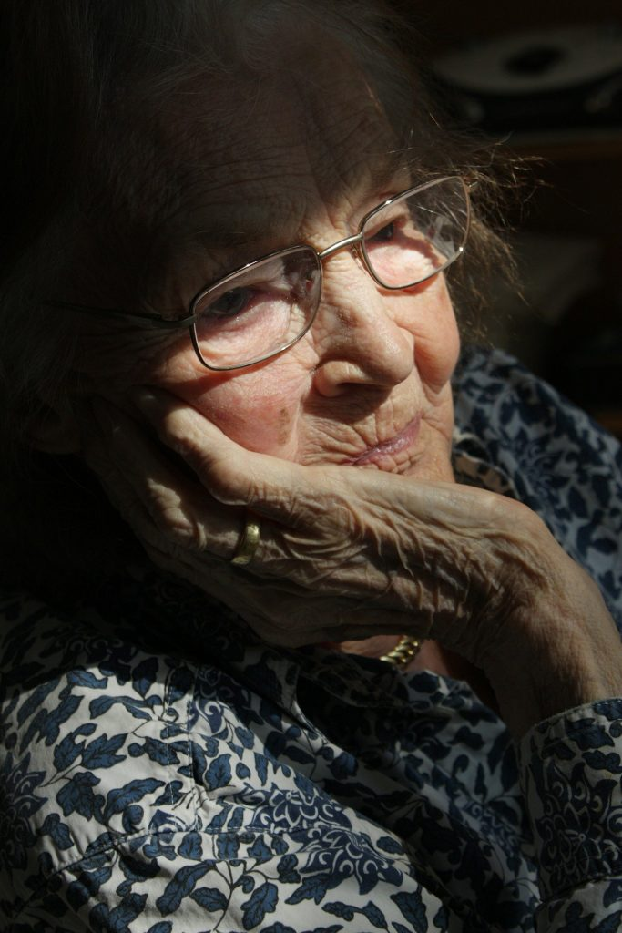 Image of an old woman with a resigned expression