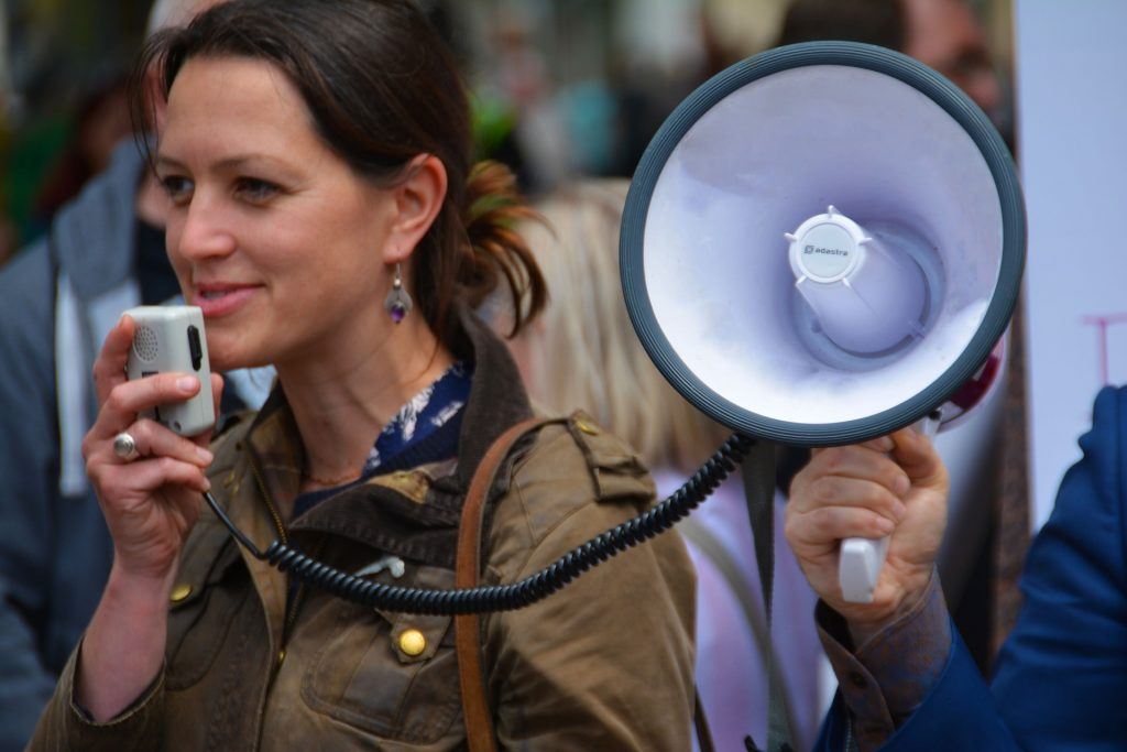 Woman talking through a megaphone