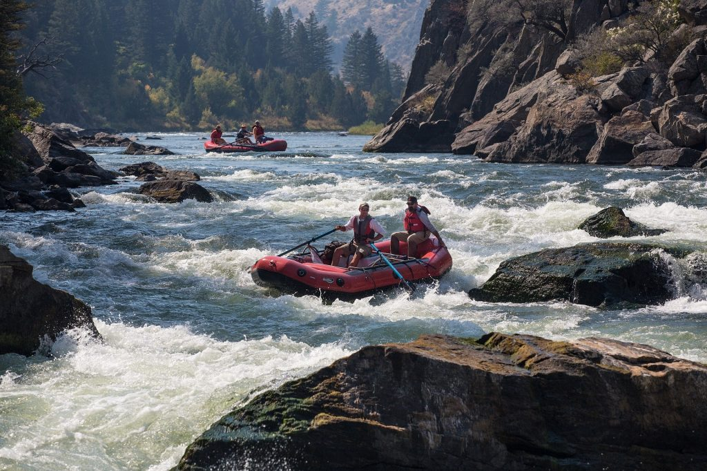River rafters confront rapids.