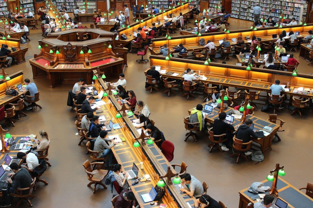 Aerial view of a large library containing laptops and books
